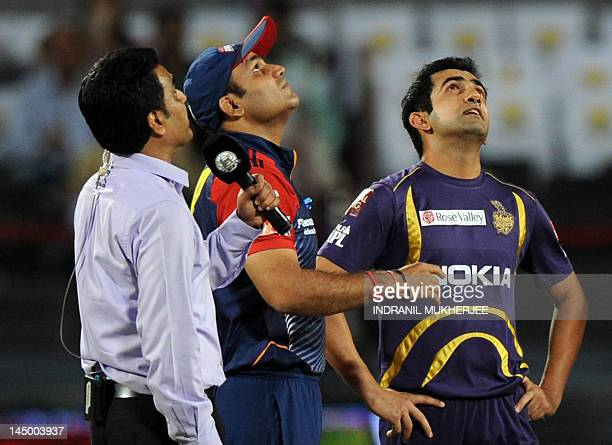 Former Indian cricketer and television presenter Sanjay Manjrekar Delhi Daredevils captain Virender Sehwag and Kolkata Knight Riders captain Gautam...