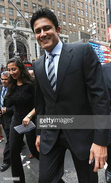 Former Indian cricketer Anil Kumble walks in Times Square outside the NASDAQ MarketSite on August 17 2012 in New York City Kumble rang the closing...