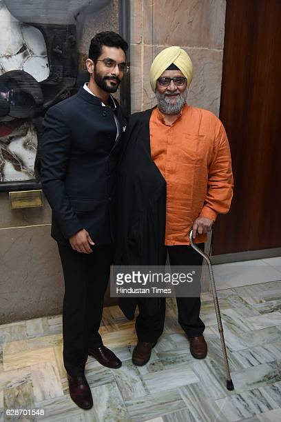 Former Indian cricketer Bishan Singh Bedi with his son and actor Angad Bedi during the wedding reception of Indian Cricketer Yuvraj Singh and...