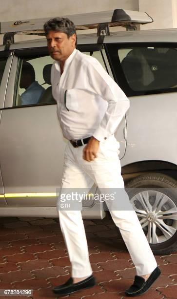 Former Indian cricketer Kapil Dev arrives to attend a prayer meeting for the late actor and politician Vinod Khanna in Mumbai on May 3 2017 / AFP...