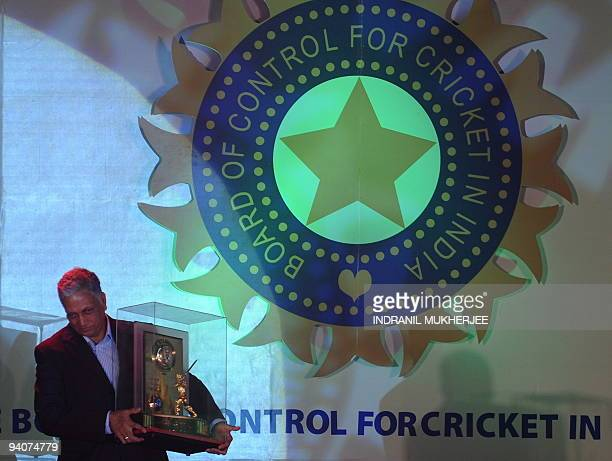 Former Indian cricketer Mohinder Amarnath holds the CKNaydu trophy lifetime achievement award for contribution to Indian cricket at the BCCI annual...