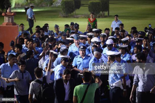 Former Indian cricketer Sachin Tendulkar an honorary Indian Air Force Group Captain walks with Indian Air Force personnel and others after the...