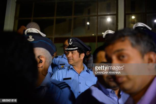 Former Indian cricketer Sachin Tendulkar an honorary Indian Air Force Group Captain looks on after the preview of the film 'Sachin A Billon Dreams'...