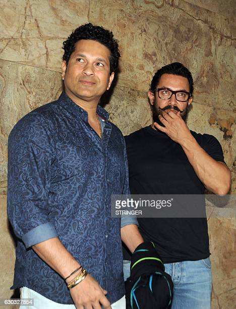Former Indian cricketer Sachin Tendulkar and Bollywood actor Aamir Khan attend the special screening of the biographical sports drama Hindi film...