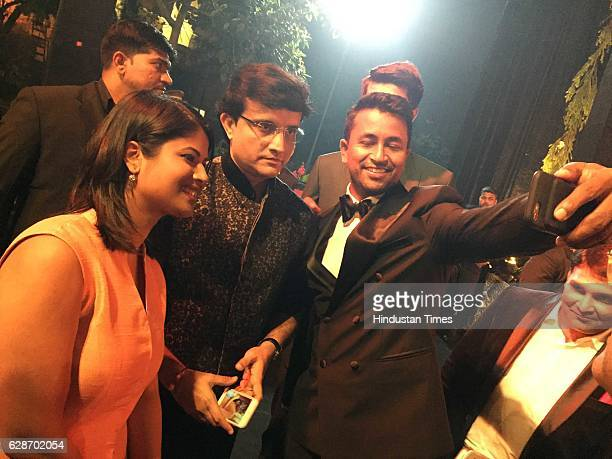 Former Indian cricketer Sourav Ganguly with cricketer Pragyan Ojha and his wife Karabi Baral during the wedding reception of Indian Cricketer Yuvraj...