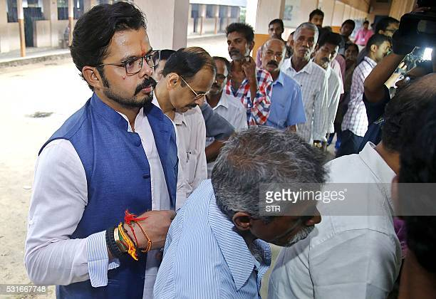 Former Indian cricketer turned Bharatiya Janata Party politicial candidate Sreesanthqueues with others to cast his vote at a polling station at St...
