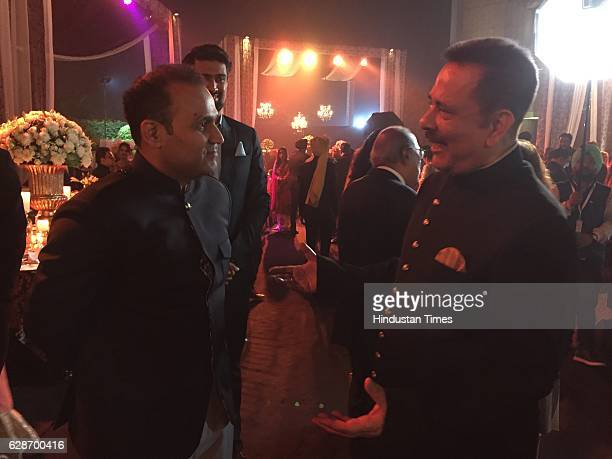 Former Indian cricketer Virender Sehwag with Sahara Group Chief Subrata Roy during the wedding reception of Indian Cricketer Yuvraj Singh and...