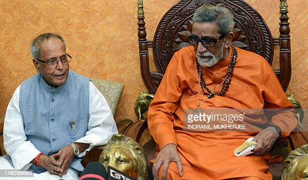 Former Indian Finance Minister and UPA candidate for the post of President of India Pranab Mukherjee speaks with Hindu right wing party Shiv Sena...