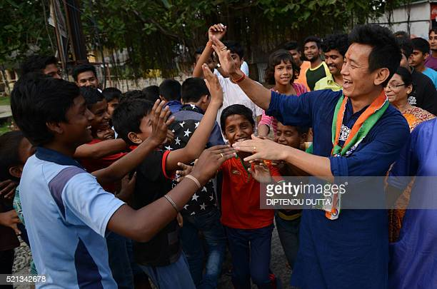 Former Indian football team captain and Trinamool Congress candidate for the Darjeeling constituency Baichung Bhutiainteracts with residents during a...