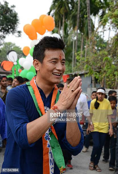 Former Indian football team captain and Trinamool Congress candidate for the Darjeeling constituency Baichung Bhutia interacts with residents during...