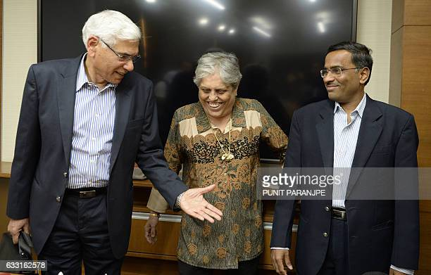 Former Indian government auditor Vinod Rai gestures towards former India women cricket captain Diana Edulji as banker Vikram Limaye looks on during a...