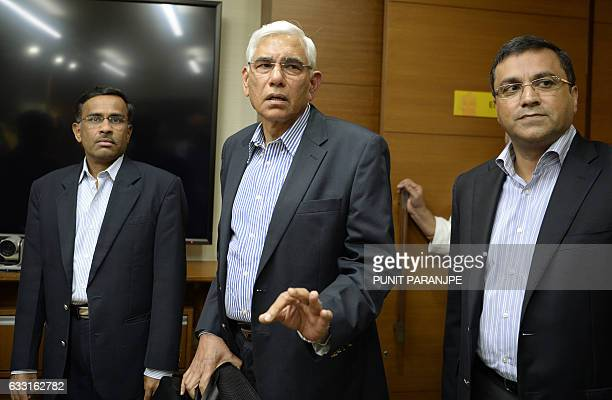 Former Indian government auditor Vinod Rai speaks to the media as CEO of the Board of Control for Cricket Rahul Johri and banker Vikram Limaye look...