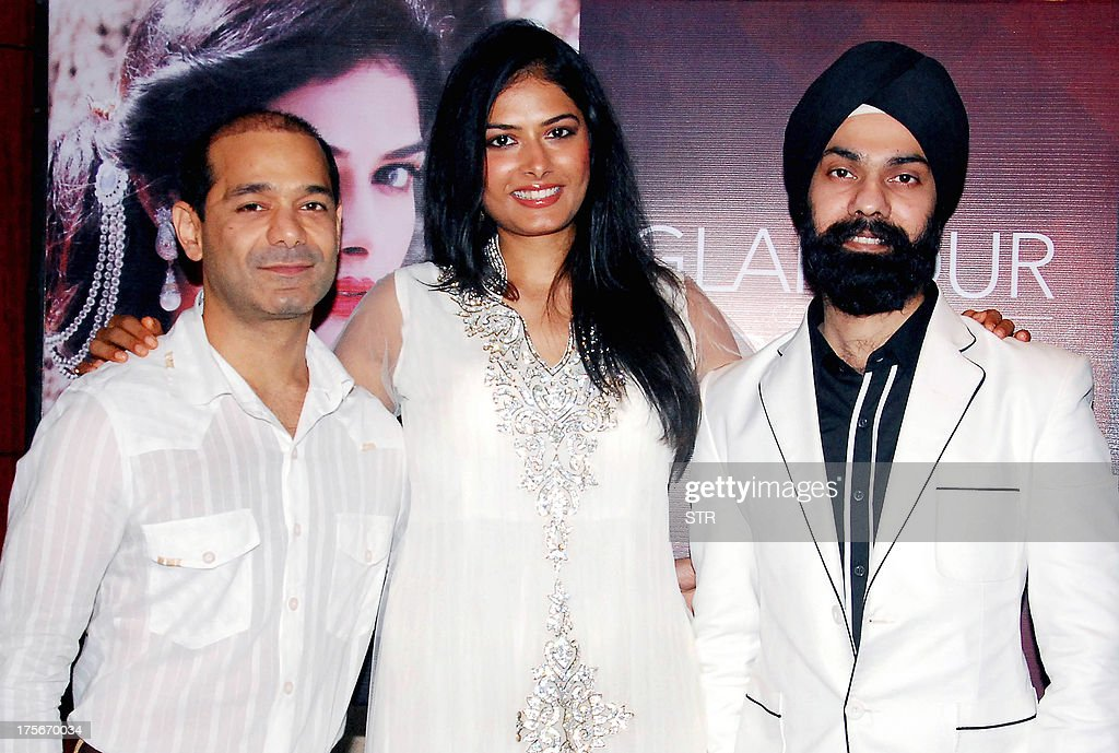 Former Indian Miss Tourism World Model Priyanka Shah, (C) and brand ambassdor for the 'Signature Premier Pune Style Week 2013' poses with Indian dress designers, AD Singh (R) and Jatin Kochhar at the press conference announcing the three day fashion festival in Pune on August 5, 2013.
