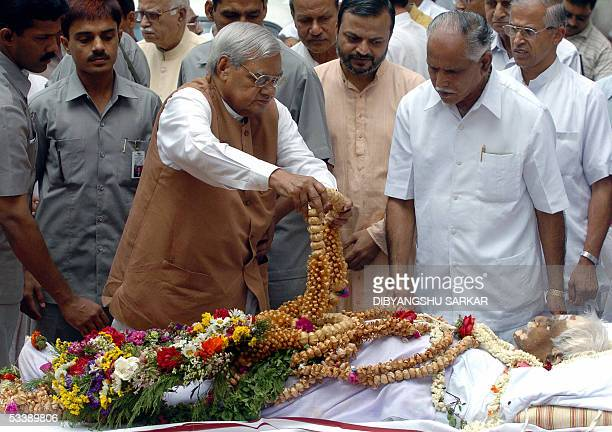 Former Indian Prime Minister Atal Behari Vajpayee lays a garland as he pays his respects to the late leader of the extremist Hindu right wing...