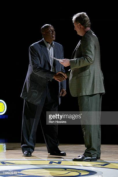 Former Indiana Pacer George McGinnis shakes the hand of Pacers President of Basketball Operations Larry Bird as McGinnis was voted by the fans to be...