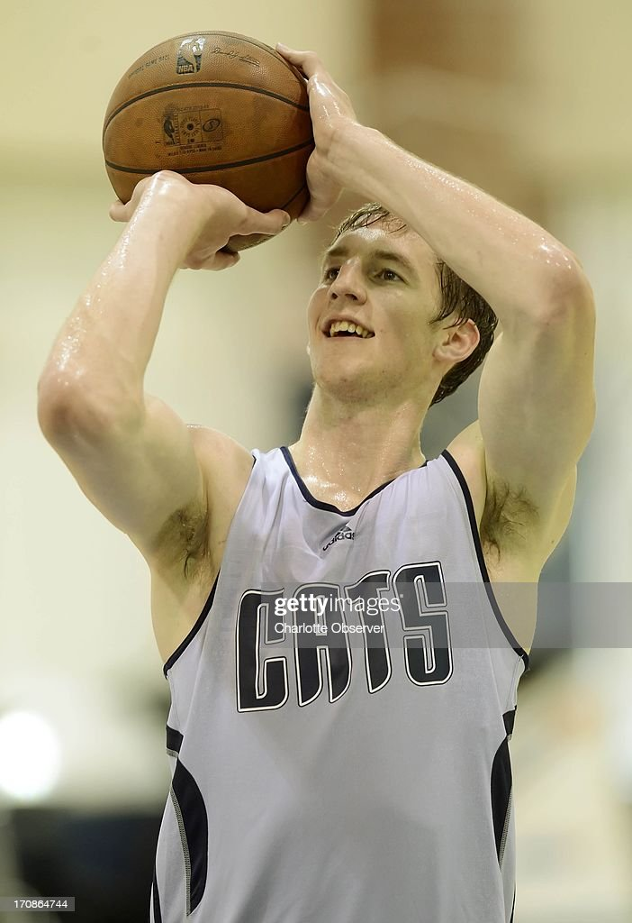 Former Indiana star Cody Zeller smiles as he shoots during a Charlotte Bobcats pre-draft workout, Wednesday, June 19, 2013, in Charlotte, North Carolina.