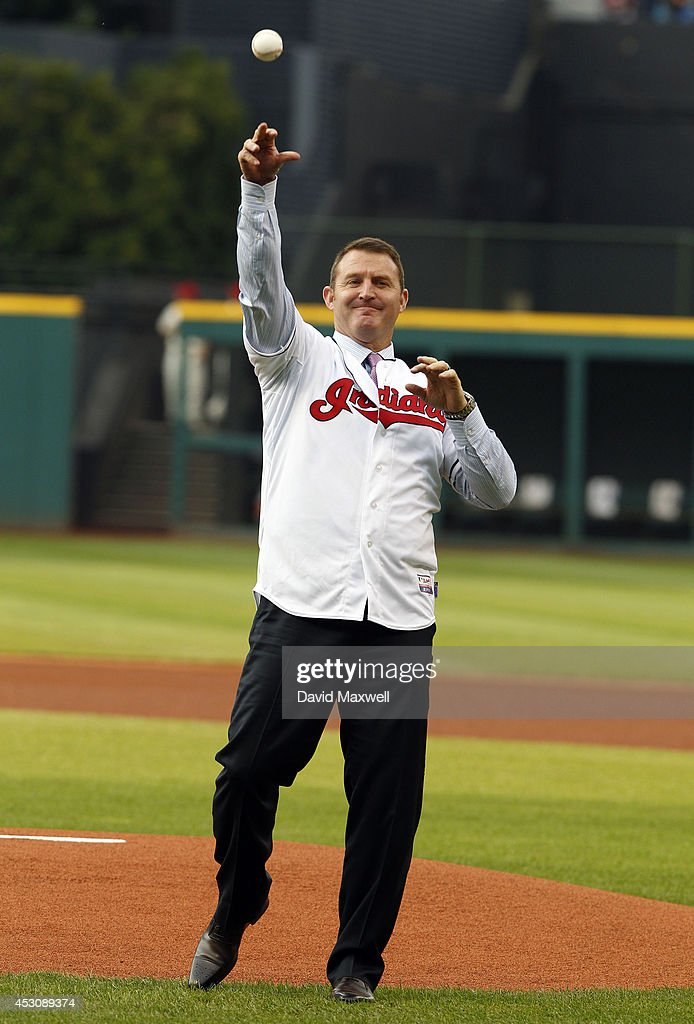 Former Indians great <a gi-track='captionPersonalityLinkClicked' href=/galleries/search?phrase=Jim+Thome&family=editorial&specificpeople=202878 ng-click='$event.stopPropagation()'>Jim Thome</a> #25 throws out the first pitch before the game between the Cleveland Indians and the Texas Rangers on August 2, 2014 at Progressive Field in Cleveland, Ohio.