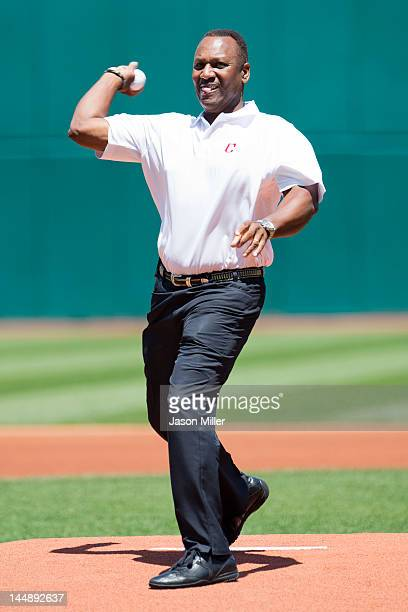 Former Indians great Joe Carter throws out the first pitch prior to the game between the Cleveland Indians and the Miami Marlins during interleague...