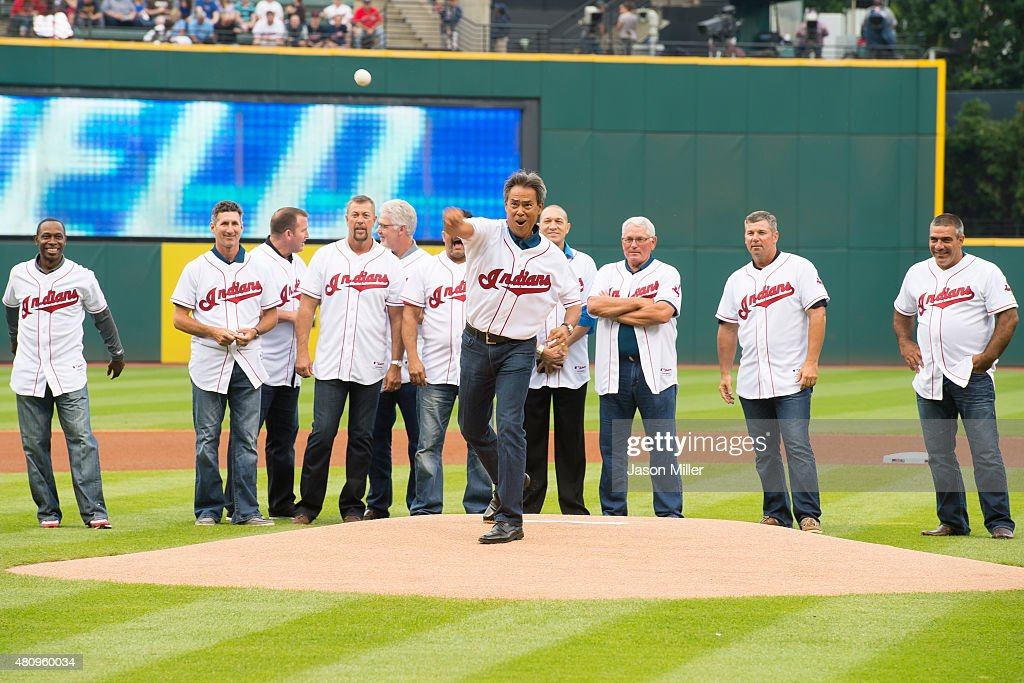 Former Indians player Dennis Martinez throws out the first pitch as fellow members of the 1995 Cleveland Indians team watch prior to the game against the Tampa Bay Rays at Progressive Field on June 19, 2015 in Cleveland, Ohio.