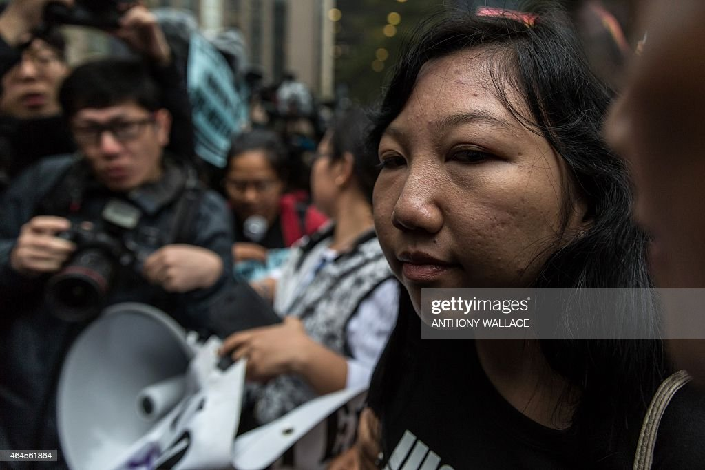 Former Indonesian domestic helper <a gi-track='captionPersonalityLinkClicked' href=/galleries/search?phrase=Erwiana+Sulistyaningsih&family=editorial&specificpeople=12341887 ng-click='$event.stopPropagation()'>Erwiana Sulistyaningsih</a>, 24, (R) arrives at the District Court before the sentencing of her former employer Law Wan-tung, 44, in Hong Kong on February 27, 2015. Law, found guilty of beating and starving Sulistyaningsih and keeping her prisoner, faces up to seven years in prison when she appears in court for sentencing February 27.