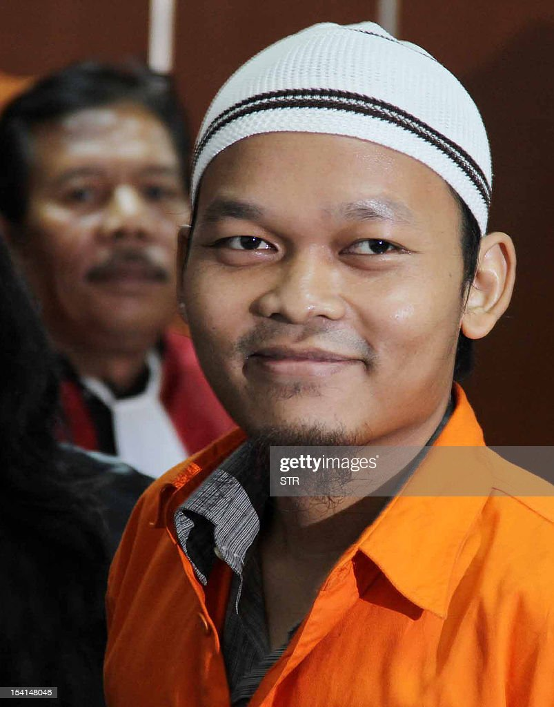 Former Indonesian police officer Mohamad Said Haryadi leaves the court in Jakarta on October 15, 2012 after he was sentenced to three-and-half years in jail for hiding suspects in the suicide bombing of a police mosque. Haryadi, 30, was found guilty of hiding two people later convicted of helping the attack on the mosque in Cirebon, western Java, last year which injured 30 people -- mostly police -- during prayers.