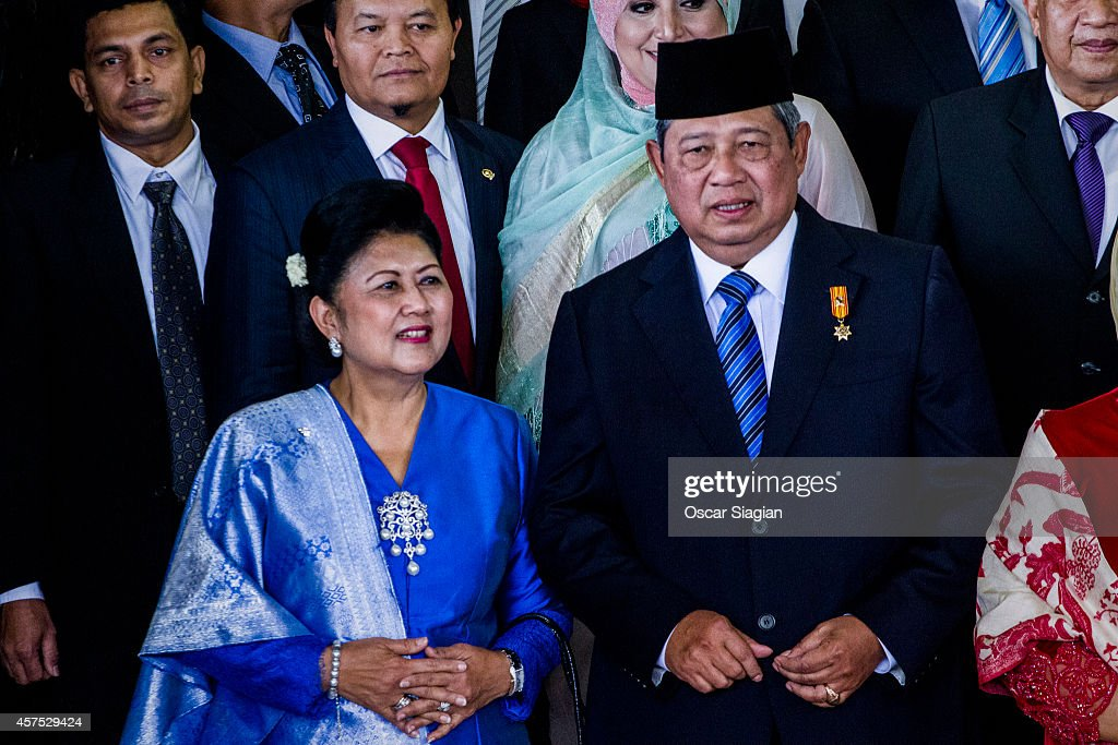 Former Indonesian President Susilo Bambang Yudhoyono (R) and his wife Ani Yudhoyono leaves the inauguration ceremony for President Joko Widodo at the House of Representative building on October 20, 2014 in Jakarta, Indonesia. Joko Widodo is today sworn in as the president of Indonesia with an inauguration ceremony held in Jakarta. Widodo was the eventual winner of a tightly fought and sometimes controversial election race against opposition candidate Prabowo Subianto. A number of key world leaders will be in attendance including Australia's prime minister Tony Abbott.
