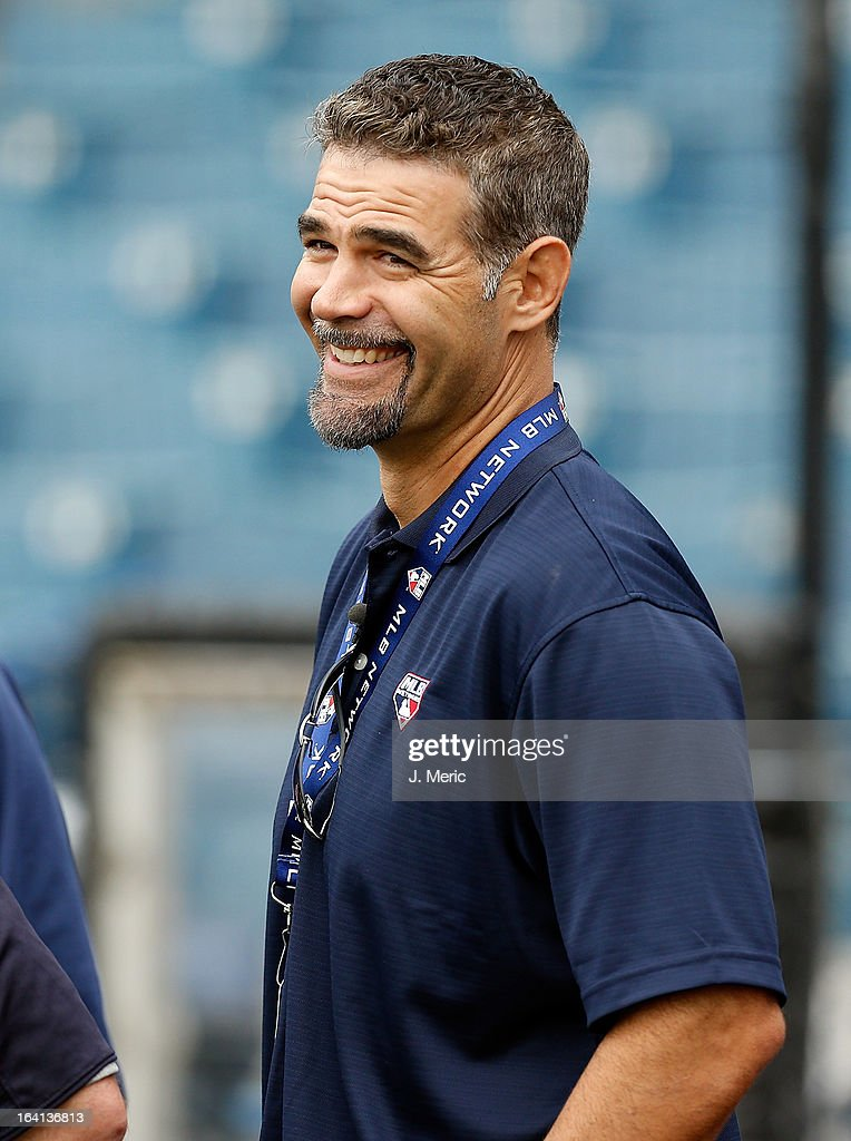 Former infielder Mike Lowell of the Boston Red Sox smiles during batting practice just before the Grapefruit League Spring Training Game against the...