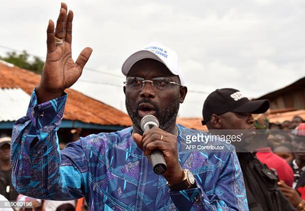 Former international Liberian football star turned politician George Weah addresses supporters during a campaign rally in Monrovia on October 8 three...