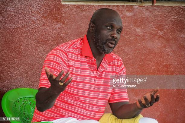 Former international Liberian soccer star turned politician George Weah speaks during an interview in Monrovia on July 7 2017 / AFP PHOTO / Zoom DOSSO
