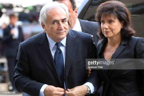 Former International Monetary Fund chief Dominique StraussKahn enters Manhattan Supreme Court with his wife Anne Sinclair on where he is expected to...