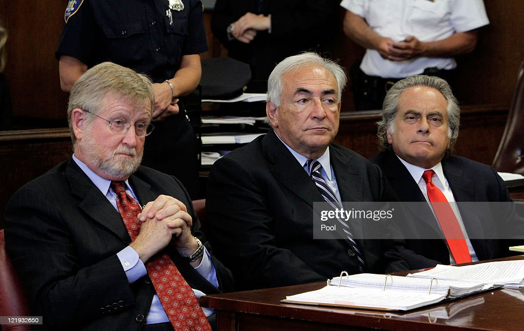 Former International Monetary Fund (IMF) director <a gi-track='captionPersonalityLinkClicked' href=/galleries/search?phrase=Dominique+Strauss-Kahn&family=editorial&specificpeople=227268 ng-click='$event.stopPropagation()'>Dominique Strauss-Kahn</a> appears before a judge with his lawyers lawyers, William Taylor (L) and <a gi-track='captionPersonalityLinkClicked' href=/galleries/search?phrase=Benjamin+Brafman&family=editorial&specificpeople=2776479 ng-click='$event.stopPropagation()'>Benjamin Brafman</a> (R) in Manhattan district court on August 23, 2011 in New York City. A judge officially granted the Manhattan District Attorney's office motion to dismiss charges against Strauss-Kahn who was accused by Nafissatou Diallo, a hotel maid of sexual assault charges.