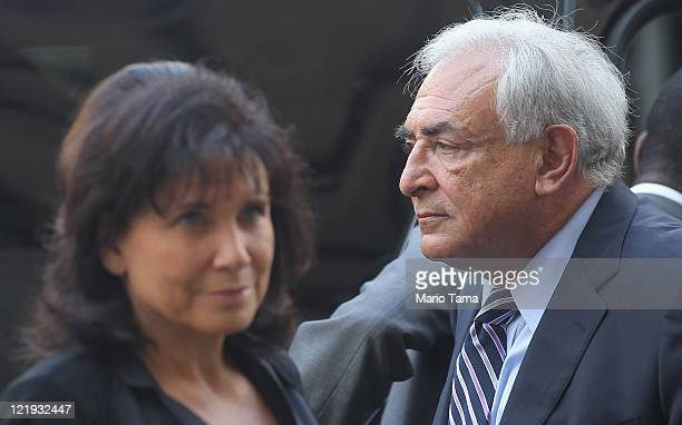 Former International Monetary Fund director Dominique StraussKahn enters Manhattan State Supreme Court with his wife Anne Sinclair on August 23 2011...