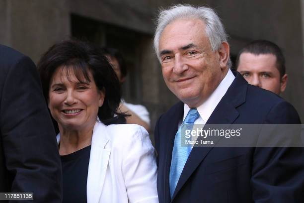 Former International Monetary Fund leader Dominique StraussKahn and his wife Anne Sinclair leave a hearing where he was released on his own...