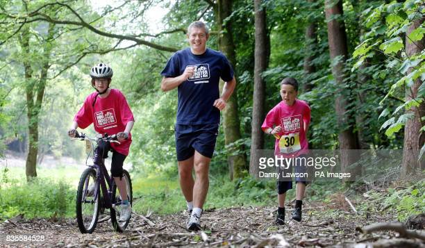 Former international rugby star Gavin Hastings warms up with brother and sister Ross and Kerry Docherty ahead of the Mini Monster Challenge in Pollok...