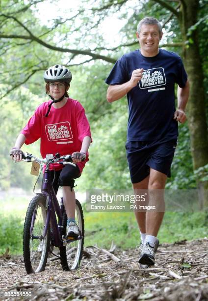 Former international rugby star Gavin Hastings warms up with Kerry Docherty ahead of the Mini Monster Challenge in Pollok Park Glasgow