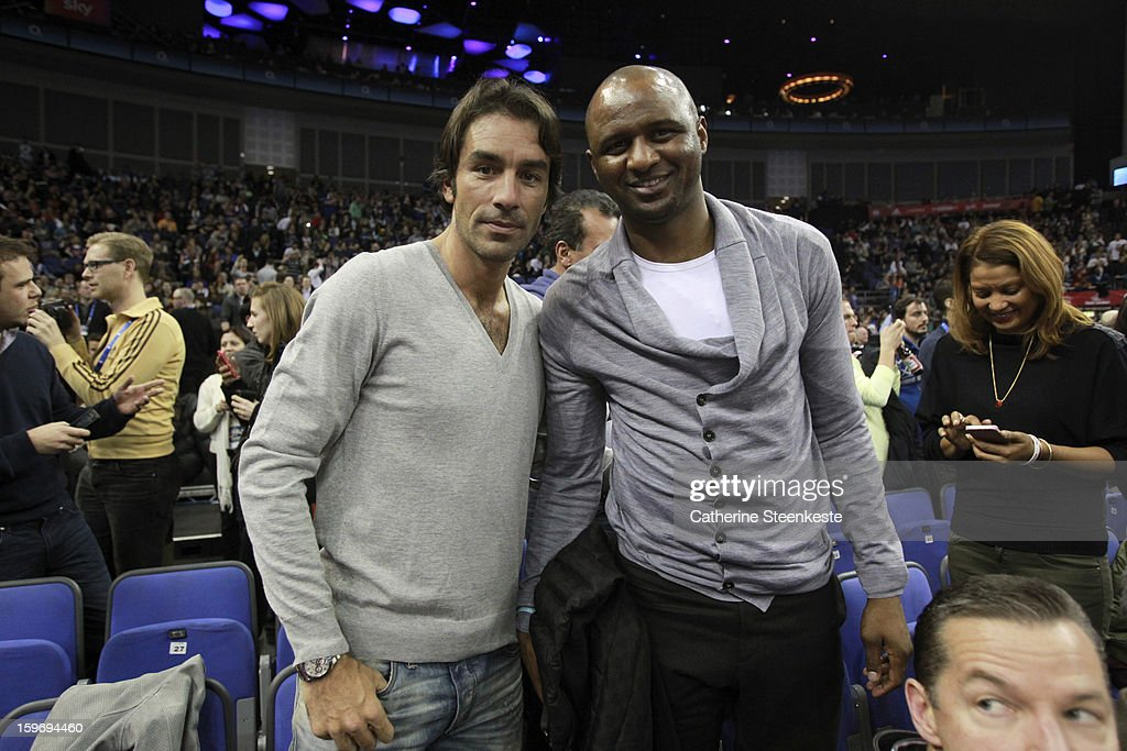 Former international soccer players <a gi-track='captionPersonalityLinkClicked' href=/galleries/search?phrase=Robert+Pires&family=editorial&specificpeople=167225 ng-click='$event.stopPropagation()'>Robert Pires</a> and Patrick Viera are posing for a picture during a game between New York Knicks and the Detroit Pistons at the O2 Arena on January 17, 2013 in London, England.