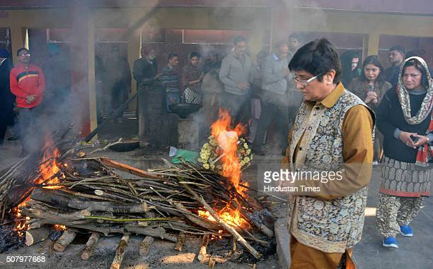 Former IPS officer and social activist Kiran Bedi with relatives during the cremation of her husband Brij Bedi at Shivpuri near Durgiana Temple on...