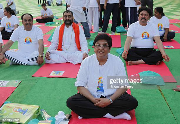 Former IPS officer Kiran Bedi participates in a mass yoga performance led by Prime Minister Narendra Modi to mark the International Day of Yoga at...