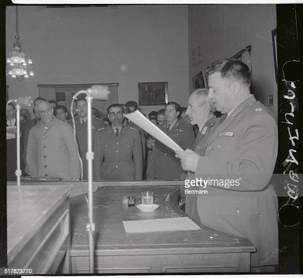 Former Iranian Premier Mohammed Mossadegh is shown standing in court as he heard the reading of the verdict for treason Early in his trail Mossadegh...