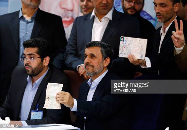 Former Iranian president Mahmoud Ahmadinejad displays identification at the Interior Ministry's election headquarters as candidates begin to sign up...