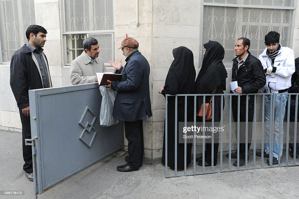 Former Iranian President Mahmoud Ahmadinejad speaks to supporters and receives letters requesting help outside his home at 'Square 72' in the...