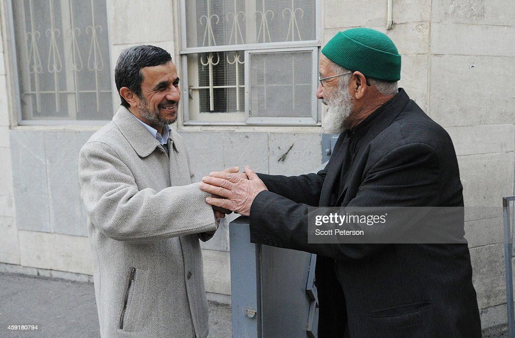 Former Iranian President <a gi-track='captionPersonalityLinkClicked' href=/galleries/search?phrase=Mahmoud+Ahmadinejad&family=editorial&specificpeople=221337 ng-click='$event.stopPropagation()'>Mahmoud Ahmadinejad</a> speaks to supporters and receives letters requesting help outside his home at 'Square 72' in the working-class Narmak district on November 15, 2014 in eastern Tehran, Iran. Though his eight years as president ended in 2013 among a wave of political attacks at home and weariness in the West over his constant anti-Israel rhetoric and questioning of the scale of the Holocaust, Mr. Ahmadinejad and his very active supporters are raising his public profile amid rumors of a comeback run for parliament or higher office.