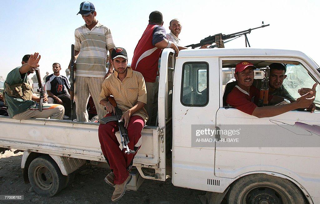 Former Iraqi insurgents members of the Sunni Anbar Awakening guard a meeting between Sunni and Shiite tribe leaders and clerics in alDuwanem...