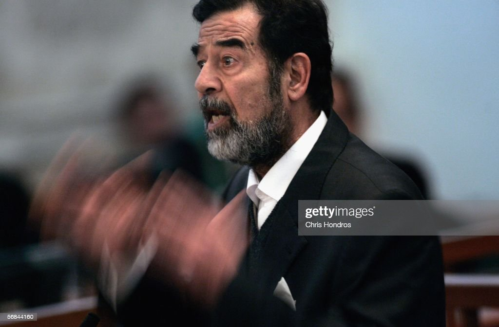 Former Iraqi President Saddam Hussein addresses the court of the Iraqi High Tribunal inside the heavily fortified Green Zone on February 14, 2006 in Baghdad, Iraq. The trial of Saddam Hussein and his seven co-defendants continues with witness testimony today.