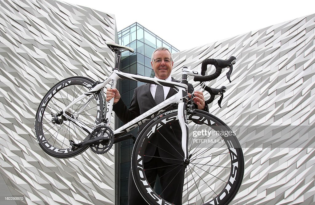 Former Irish cyclist and former Giro d'Italia winner Stephen Roche poses for pictures with a bicycle during a media launch for the Giro d'Italia at the Titanic Centre in Belfast, Northern Ireland, on February 21, 2013. Another of cycling's biggest races will start in Britain next year after organisers announced on Thursday that the Giro d'Italia will be flagged off in Northern Ireland. The 2014 edition of one of the sport's three Grand Tour races will begin in Belfast on May 10, kicking off three days of action that will also include a stage finishing in Dublin, capital of the Republic of Ireland.