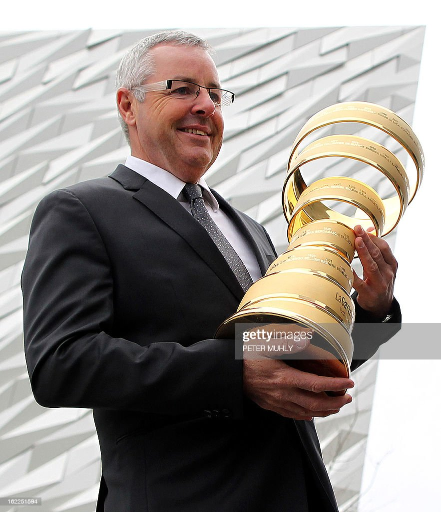 Former Irish cyclist and former Giro d'Italia winner Stephen Roche, poses with the 'Giro trophy' during a media launch at the Titanic Centre in Belfast, Northern Ireland, on February 21, 2013. Another of cycling's biggest races will start in Britain next year after organisers announced on Thursday that the Giro d'Italia will be flagged off in Northern Ireland. The 2014 edition of one of the sport's three Grand Tour races will begin in Belfast on May 10, kicking off three days of action that will also include a stage finishing in Dublin, capital of the Republic of Ireland. AFP PHOTO / PETER MUHLY
