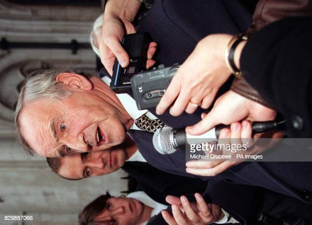 Former Irish premier Albert Reynolds is surrounded by the media outside the High Court in London this afternoon where he faced a 1 million legal...