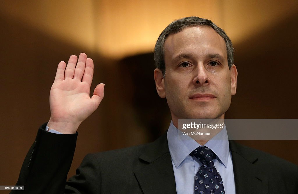 Former IRS Commissioner Douglas Shulman is sworn in prior to testifying before the Senate Finance Committee May 21 2013 in Washington DC The...