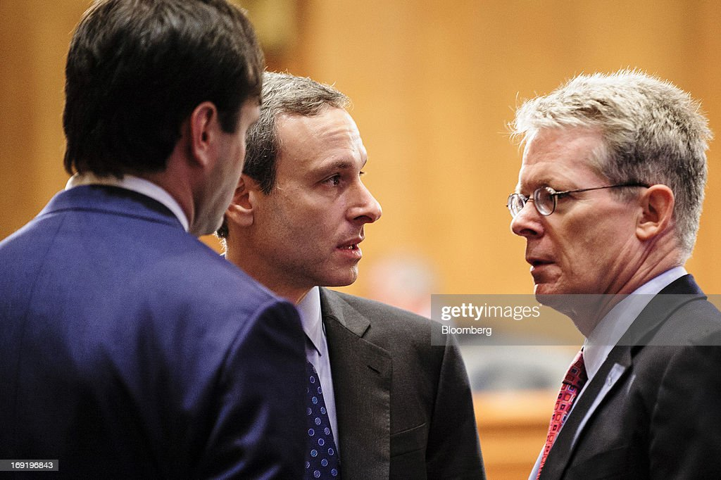 Former IRS Commissioner Douglas Shulman talks with others during a recess from his testimony before a Senate Finance Committee hearing on Capitol...