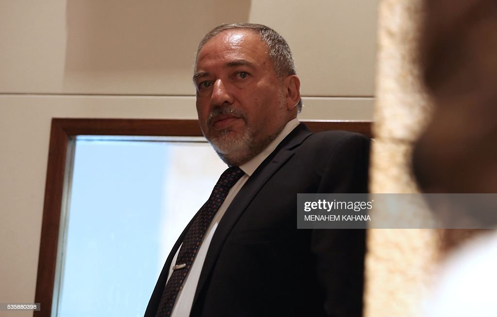 Former Israeli foreign minister and ultra-nationalist MP Avigdor Lieberman is seen during a session of the Israeli parliament in which MPs are debating whether to approve the appointment of Lieberman as defence minister, on May 30, 2016 in Jerusalem. Israeli Prime Minister Benjamin Netanyahu's cabinet voted to expand his coalition and appoint hardliner Avigdor Lieberman as defence minister, bringing weeks of political intrigue -- and outrage -- towards a close. Parliament was expected later today to approve the appointment of Lieberman, a former foreign minister and ultra-nationalist who has pledged harsh measures against Palestinian 'terrorists'. / AFP / menahem kahana